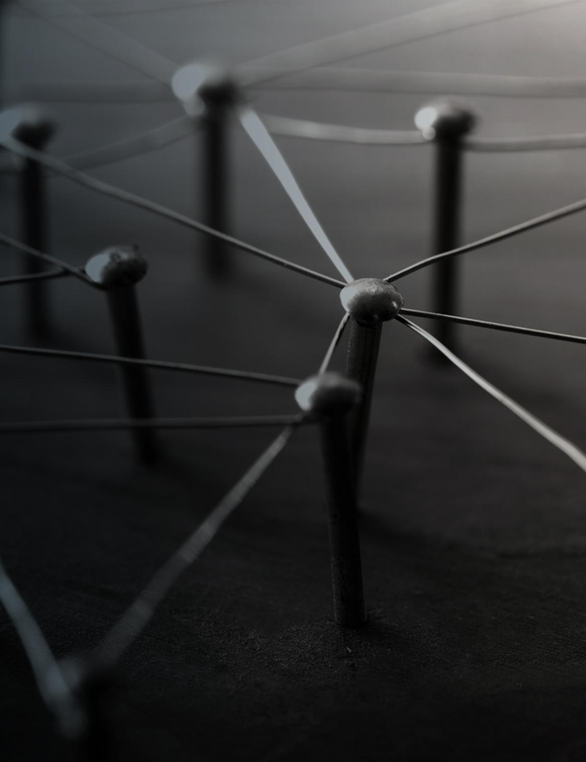 Die Vernetzung der Industrie 4.0 dargestellt mittels verbundenen Nägeln.